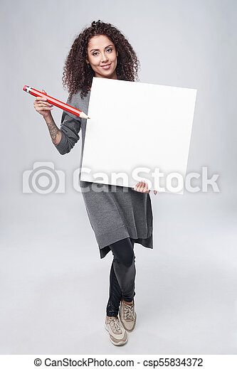 Curly woman with whiteboard - csp55834372