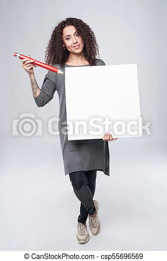 Curly woman with whiteboard - csp55696569