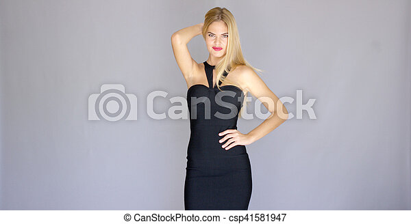 Curvaceous sexy young woman posing in elegant dress - csp41581947