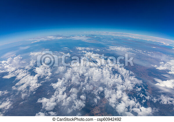 Curvature of planet earth  Aerial shot  Blue sky and clouds