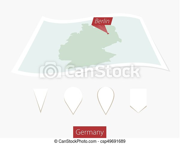 Curved paper map of Germany with capital Berlin on Gray Background. Four different Map pin set. - csp49691689