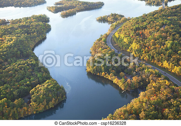 Curving road along Mississippi River during autumn - csp16236328