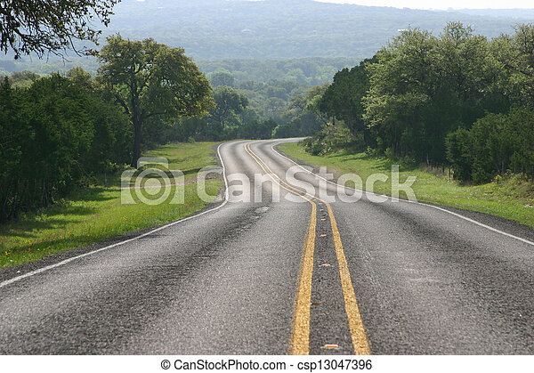 Curving road in the Texas Hill Country - csp13047396