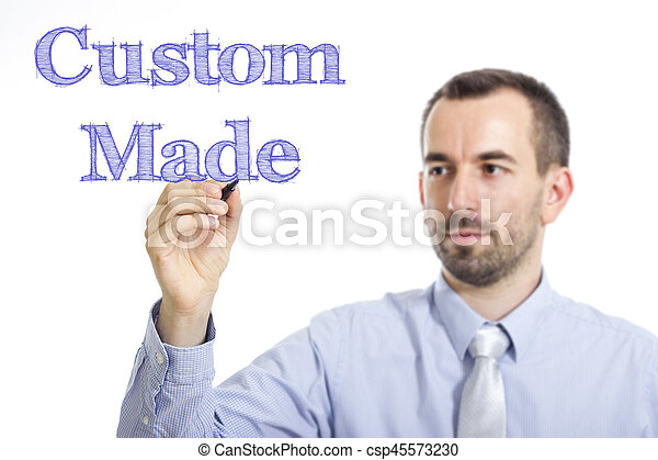 Custom Made - Young businessman writing blue text on transparent surface - csp45573230