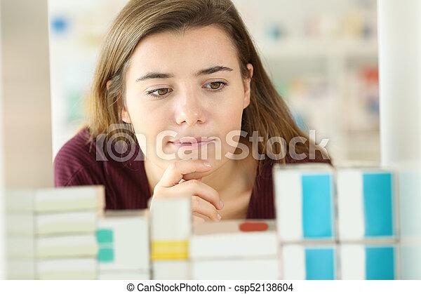 Customer choosing medicines in a pharmacy - csp52138604