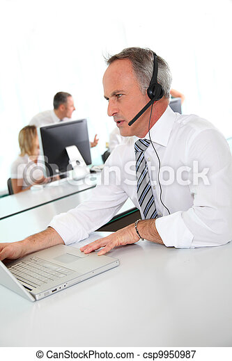 Customer service people on the phone - csp9950987