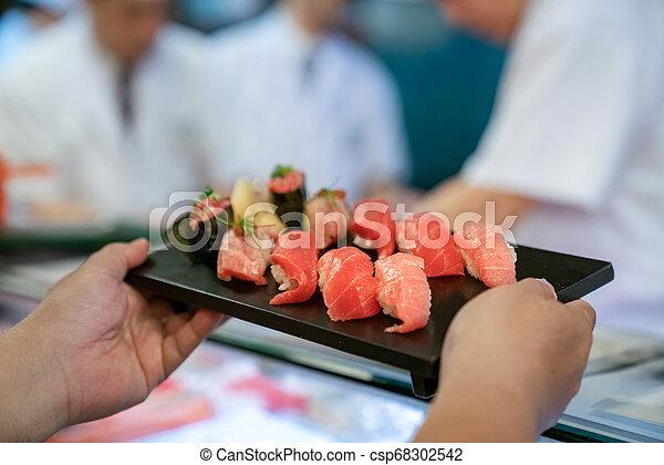 Customer take Salman Shushi from chef - csp68302542