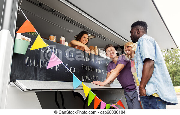 customers or friends and saleswoman at food truck