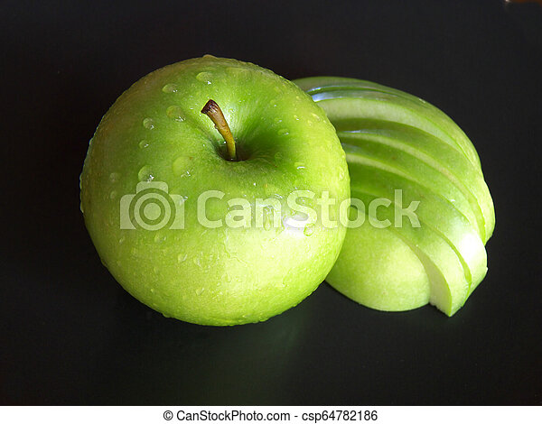 Cut apple isolated on a black background - csp64782186