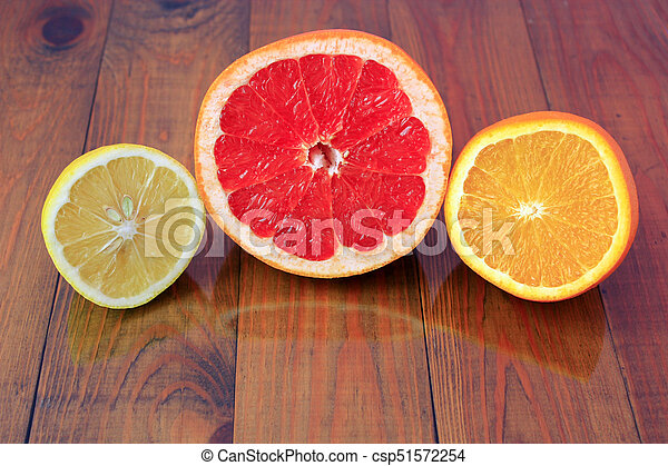 cut grapefruit orange and lemon are reflected on the surface - csp51572254
