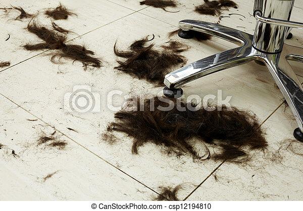 Cut hair on the floor in a hairdressing salon. - csp12194810