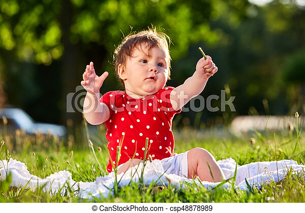 Image of: Good Morning Cute Adorable Nice Baby Girl In Red Spring Dress Smiling Sitting Under The Tree Baby Sitting On Grass In The Park Can Stock Photo Cute Adorable Nice Baby Girl In Red Spring Dress Smiling Sitting