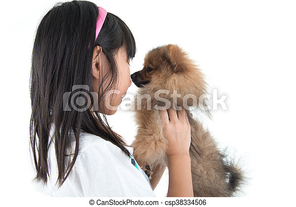 Cute Asian child with her happy doggy - csp38334506