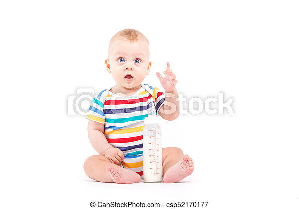 cute baby boy in colorful shirt with milk - csp52170177