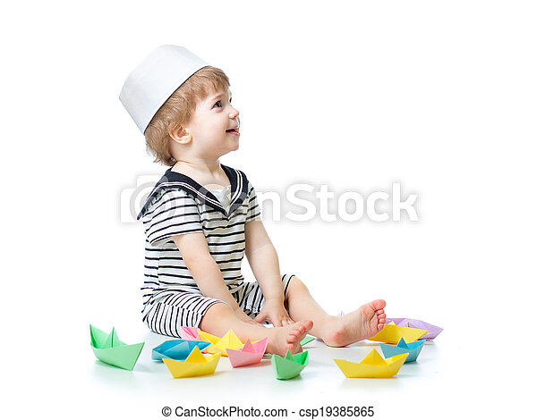 7a1ec20c7 Cute baby boy with sailor hat playing with paper boats