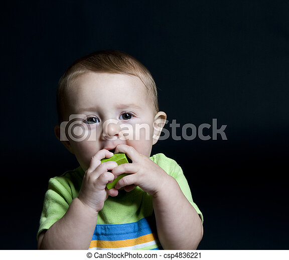 Cute Baby Chewing on Block - csp4836221