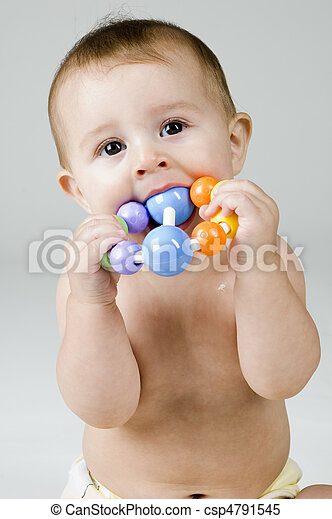 Cute Baby Chewing on Toy - csp4791545