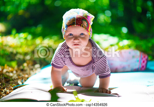 Cute baby crawling in grass  - csp14354926