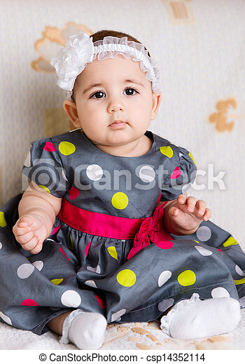 Cute baby girl in dotted dress - csp14352114