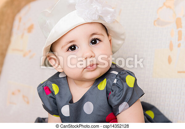 Cute baby girl in dotted dress - csp14352128