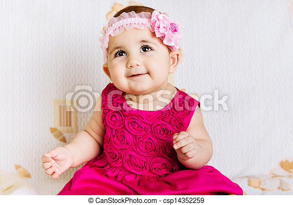 Cute baby girl in pink dress - csp14352259