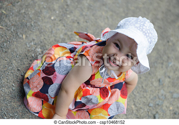 Cute baby girl in white hat  - csp10468152
