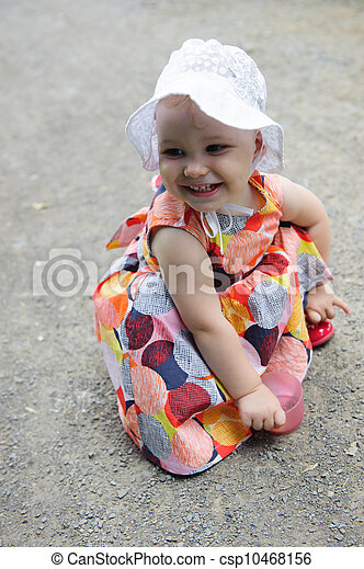Cute baby girl in white hat  - csp10468156
