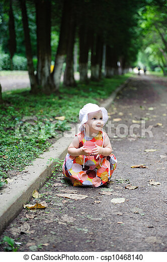 Cute baby girl in white hat  - csp10468140