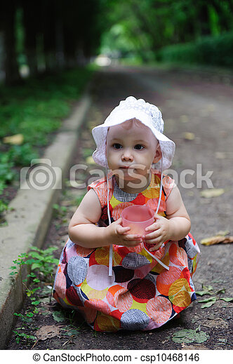 Cute baby girl in white hat  - csp10468146