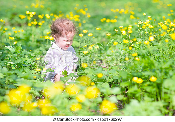 Cute baby girl playing with yellow flowers cute baby girl playing with yellow flowers csp21760297 mightylinksfo