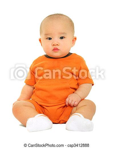 Cute Baby In Orange Shirt Puzzled - csp3412888
