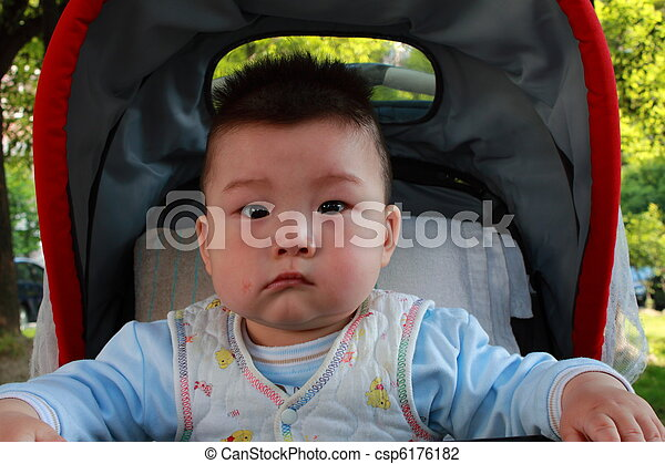cute baby in the stroller - csp6176182