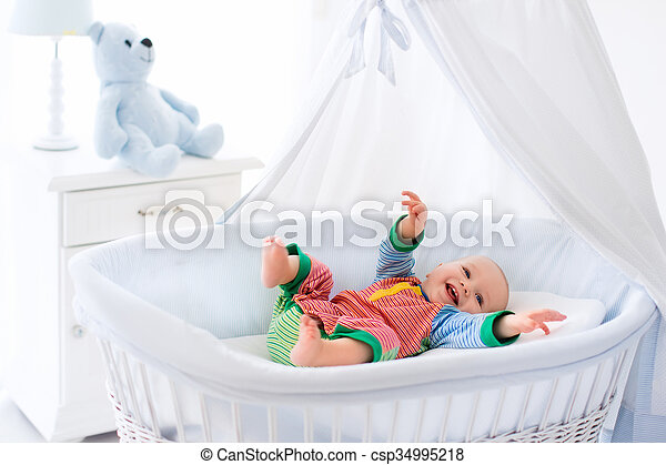 Cute baby in white nursery - csp34995218
