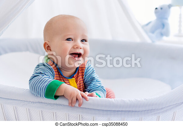 Cute baby in white nursery - csp35088450