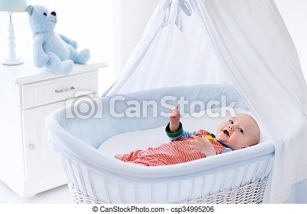 Cute baby in white nursery - csp34995206