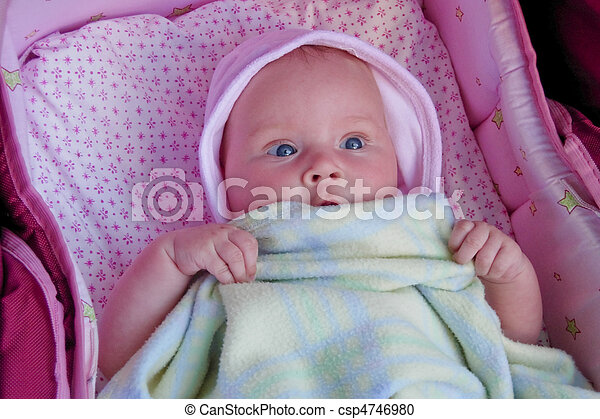 baby plays peek a boo with blanket