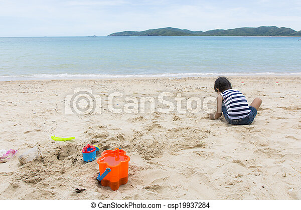 Cute baby  playing with beach toys - csp19937284