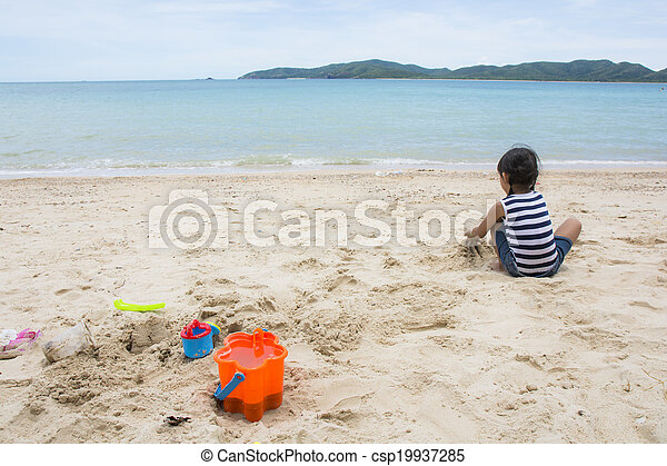 Cute baby  playing with beach toys - csp19937285