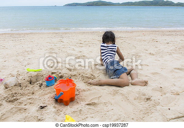 Cute baby  playing with beach toys - csp19937287