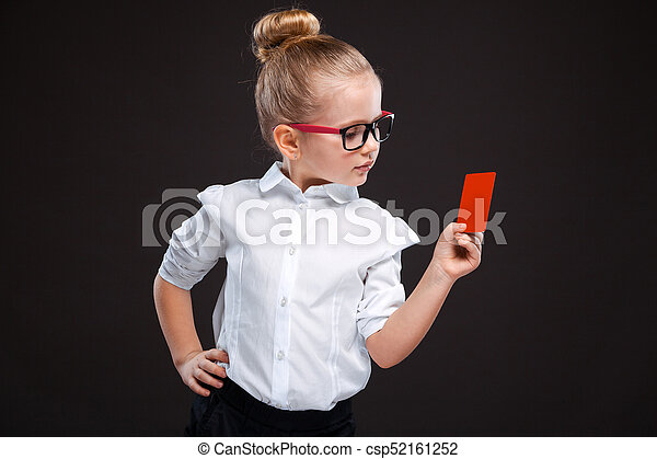 Cute beauty young girl in white shirt and black trousers hold red card - csp52161252