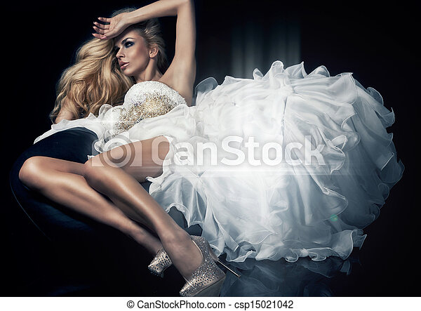 Cute blond woman in gorgeous dress - csp15021042