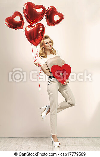 Cute blonde girl with bunch of balloons - csp17779509