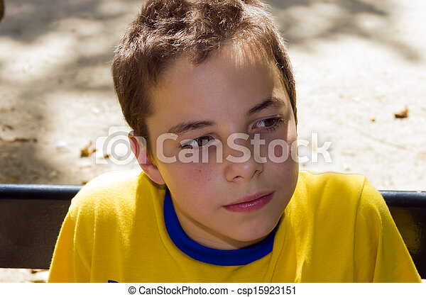 Cute boy in the park on a sunny day - csp15923151