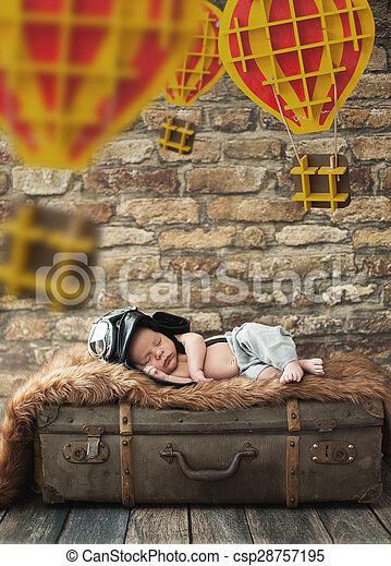 Cute boy sleeping on the luggage - csp28757195