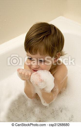 Cute boy taking a bath with foam. Cute three year old boy taking a ...