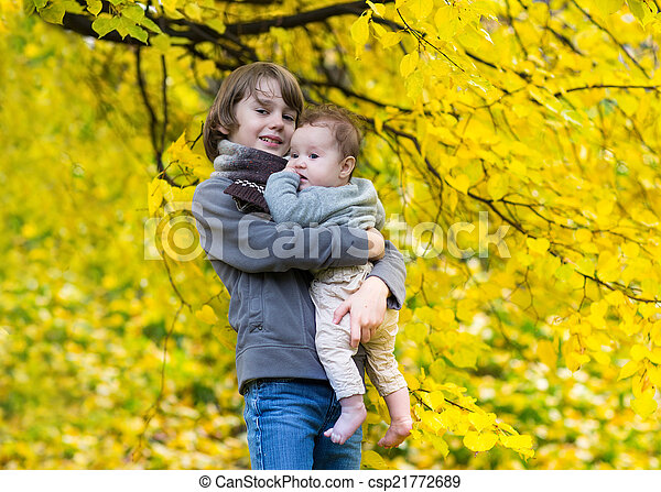 Cute Brother And His Little Baby Sister Walking In A Beautiful A