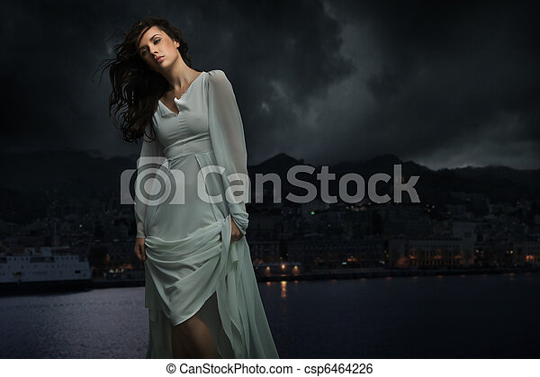 Cute brunette over city background - csp6464226