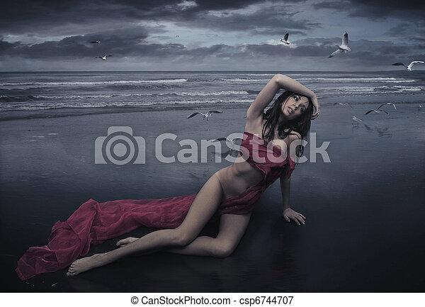 Cute brunette posing in the rain - csp6744707