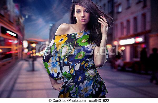 Cute brunette posing on a city street - csp6431622
