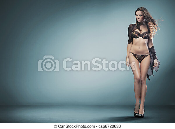 Cute brunette wearing lingerie - csp6720630